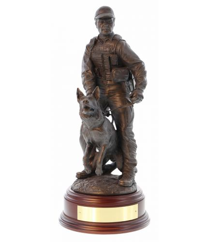 An Armed (Pistol) K9 Police Officer with his German Shepherd Dog to hand. The sculpture is 12 Inches tall, we include the standard wooden base and an engraved brass plate as standard.