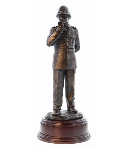 This presentation piece depicts a 'traditional' older style of British Police Constable on a daily foot patrol.  He's wearing the tunic style of uniform. The sculpture is 12 Inches tall and we include the standard wooden base and an engraved brass plate a