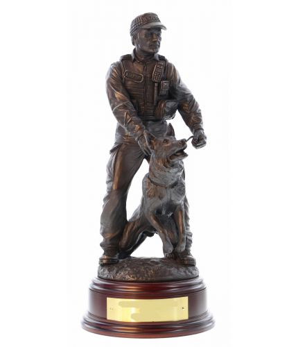 A Modern K9 British Police Officer with his German Shepherd Dog to hand. The sculpture is 12 Inches tall, we include the standard wooden base and an engraved brass plate as standard.