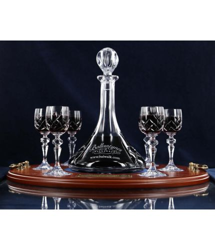 This is our Port, 7 Piece Tray Set which has a mixed cutting style. The Ships Port Decanter is engraved, however the port glasses are fully cut. We can also add an engraved brass plate to the wooden base if required.