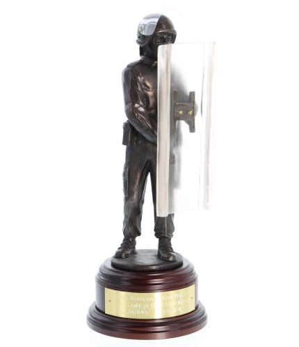 Bronze cold cast resin statuette of a modern officer of the British Prison Service in Riot Order dress. This one of our 8 inch scale statuettes and we include the wooden base and brass plate as standard.