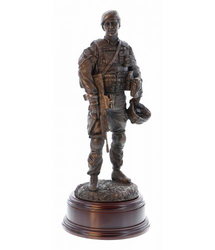 A commemorative sculpture depicting a Royal Marines Commando having a Patrol Debrief finished in cold cast bronze. Hand made by us here in the UK we also offer the engraved brass plate free of charge.