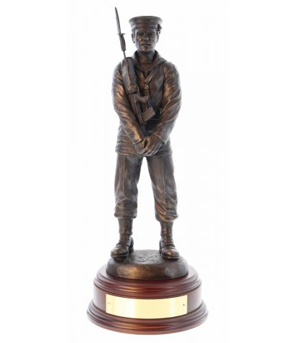 "12"" Scale sculpture of a modern Royal Navy Seaman Parade Dress. He's in a 'Stand Easy' pose which is a lovely way of displaying the Sculpture. We include this wooden base as standard, and a free brass engraving plate."