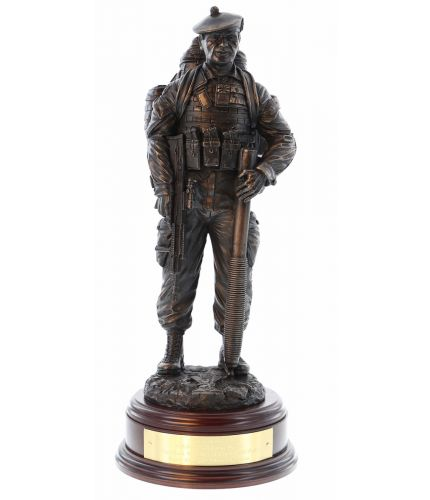 Cold cast bronze sculpture of a Royal Regiment of Scotland Mortarman. Wearing webbing and a bergan, he has his SA80 in on hand and is holding the 81mm mortar barrel in the other. We include this base and a personalised brass engraved plate.
