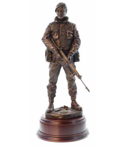 A sculpture depicting a Royal Marines Commando during the Ulster Troubles. He's on Urban Foot Patrol. A bronze commemorative presentation gift for the veteran marine. The personalised engraved plate on the base is included.
