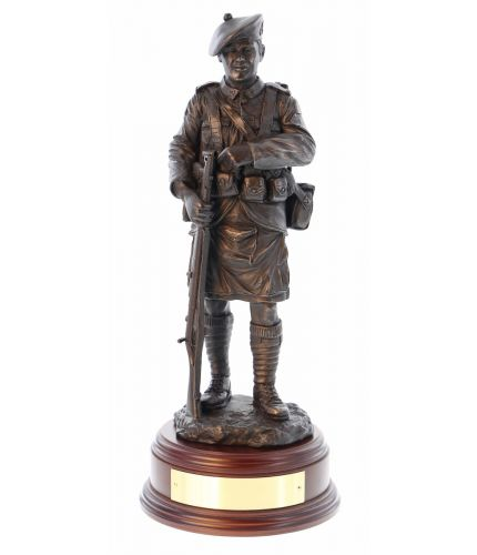 Sculpture to the young Scottish Territorials that went off to War to fight during the 1915 and 1916 campaigns. Their first major action was at Loos and both the 51st and 52nd Divisions were in action. Wooden base and brass plate included.