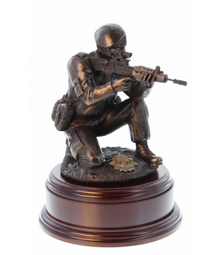 "12"" scale cold cast bronze resin sculpture of a British Army Soldier taking part in a Shooting Test. We include this wooden base, a free badging service and an engraved brass plate as standard."