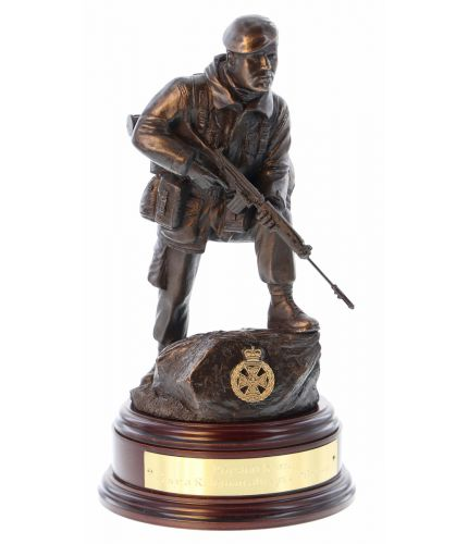 A figurine depicting a standard Brtish Army Infantryman of the 1970's and 80's. He's carrying an SLR and is wearing 58 pattern webbing, standard issue combats and a Beret. We include this wooden base, a free badging service and an engraved brass plate as