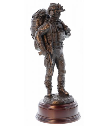 A Special Forces Trooper with his kit preparing for departure on an Operation. We call this sculpture 'Mission Ready' as it depicts life in any one of the UK, US or Special Forces Regiments. We offer a choice of wooden base and engraved plate.