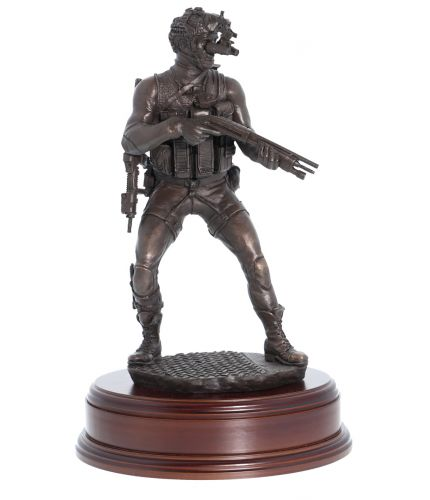 """This is a 12"""" scale sculpture of a Special Forces Frogman in the Maritime Counter Terrorist Role. We include the wooden base you can see here and an engraved brass plate as standard."""