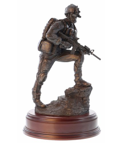"This is a 12"" scale sculpture of a Special Forces Trooper on a modern night operation. A perfect presentation gift to anyone whos serving, or has served in Special Forces Worldwide. Wooden base of Choice and brass plate included."