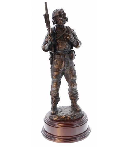 "A modern Special Forces Standing Signals Communicator in front line service. The statue stand 12"" tall and we include the wooden base and an engraved brass plate as standard. The perfect gift idea for anyone who's served in a signals role"