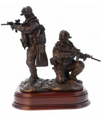 "12"" scale cold cast bronze resin sculpture of a pair of Special Forces Combat Swimmers. One is crouching and the other standing on the shoreline. We include the wooden base and an engraved brass plate with this figurine."