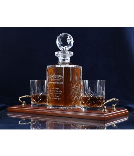 A mixed style of whisky crystal serving tray set consisting of a Decanter and two tumblers. We offer free engraving in the front panel of the decanter and a brass plate on the tray. The set is completed inside a dark blue satin lined presentation box.