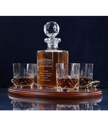 A 24% lead crystal panel cut square decanter and four fully cut whisky tumblers on a serving tray. We can offer a personalised engraving on the front of the decanter and brass plate on the wooden tray with this set.