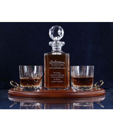 Engraved whisky decanter and tumblers on a wooden tray. Personalised engraving is included along with gift boxes.
