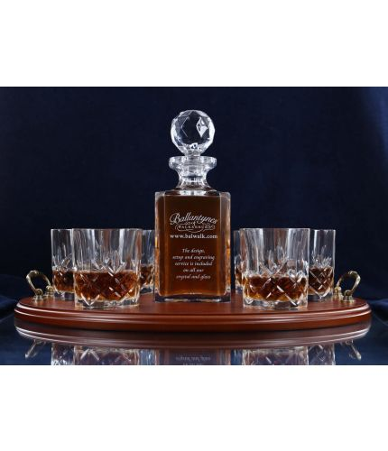 A mixed style of whisky crystal serving tray set consisting of a Decanter and six tumblers. We offer free engraving in the front panel of the decanter and a brass plate on the tray. The set is completed inside a dark blue satin lined presentation box.