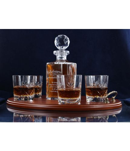 This is our very popular 7 piece panelled whisky serving tray set. It consists of a 24% lead crystal panel cut square decanter and six whisky tumblers on a serving tray with personalised hand engraving. All set up and engraving is included in the price.