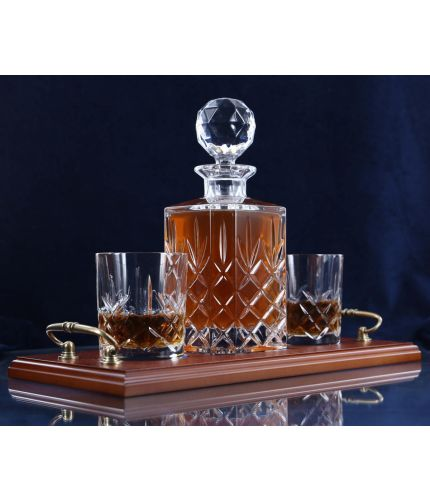 A 24% lead crystal fully cut square decanter and two fully cut whisky tumblers on a serving tray. We can offer a personalised brass plate on the wooden tray with this set.