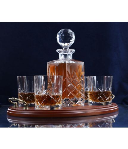 A 24% lead crystal fully cut square decanter and four fully cut whisky tumblers on a serving tray. We can offer a personalised brass plate on the wooden tray with this set.
