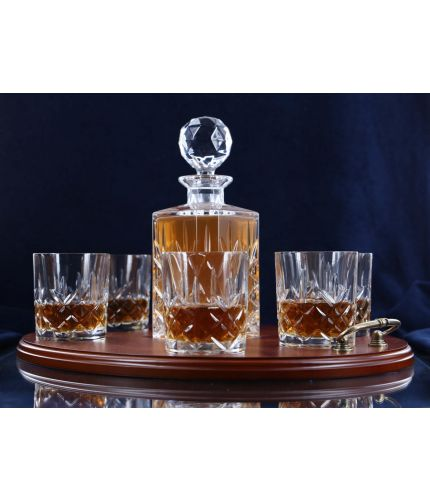 A 24% lead crystal fully cut square decanter and six fully cut whisky tumblers on a serving tray. We can offer a personalised brass plate on the wooden tray with this set.