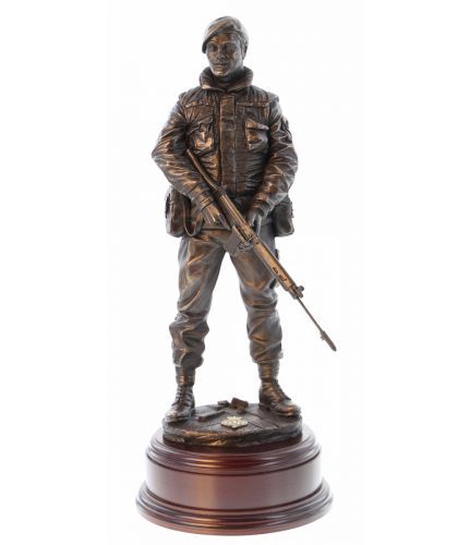 "12"" scale cold cast bronze resin sculpture of a soldier on Urban patrol in Northern Ireland during the Troubles. We include this wooden base, a free badging service and an engraved brass plate as standard."