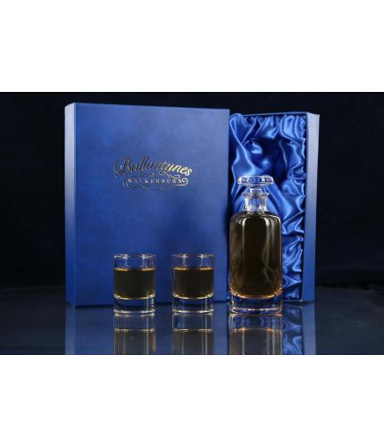 A Wee Dram Set consisting of two mini dram glasses and small glass decanter. We offer free engraving in the front panels of each piece of glass and the set is completed inside a dark blue satin lined presentation box.
